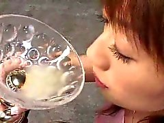 Asian girl drinks cum from glass