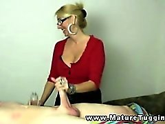 Blonde mature tugs on his hard cock