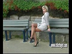 Sexy blonde with long shapely legs teases in tall black stiletto heels