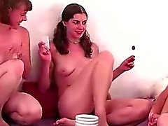 Lesbian amateurs kissing in party game group sex