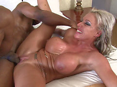 Wench with massive titties is addicted to darksome cocks