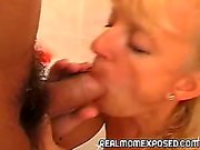 Blonde mom sucks a bushy cock