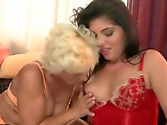 Granny and young girl having lesbian fun