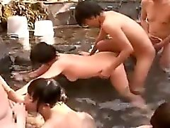 Horny Asian hotties suck and ride hard cocks in a group sex