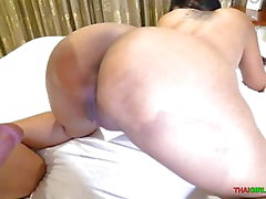 Big tit Asian MILF rides white cock