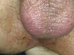 Handjob with her foot in his ass