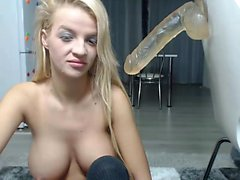 Tanned blonde with natural boobs gives blowjob to huge dick
