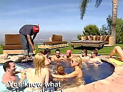 Couple swingers having fun by the pool and enjoying it