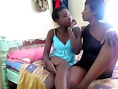 Two horny black sluts sharing one big dildo