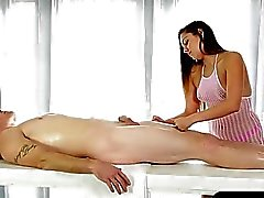 Hot masseuse gives a nice blowjob under the massage table