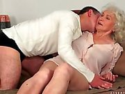 Kissing granny and sucking her sexy tits