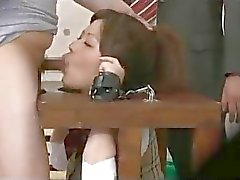 Schoolgirl Tied To Stocks Sucking Schoolguys Getting Her Mouth Fucked Cums To Mouth In The Gym
