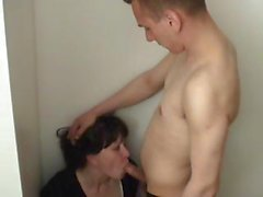 Naughty young stepson gets sucked and fucked by brunette mom