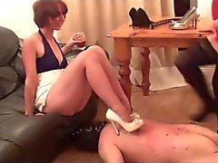 slave getting high heel torture from 2 mistresses