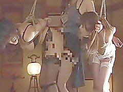 Two Asian sluts hanging on ropes as they are bdsme