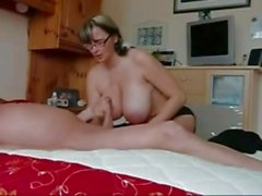 Saucy amateur gets her tits glazed with thick cum