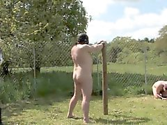 Femdom dominas torment worthless subs on whipping post