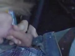 kinky blonde in latex gets done outdoors in a car