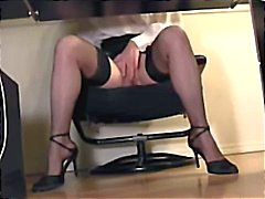 Spying after an office bitch as she masturbates under her table at work