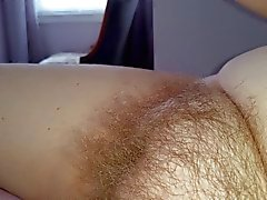 my wife caressig the long hairs on her own hairy pussy