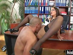 Good looking girl pleases her boss