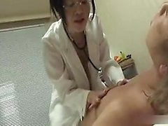 Kinky Japanese lady with glasses sticks a banana in her fie