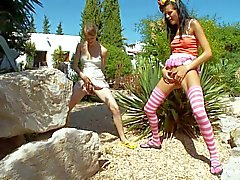 Beata and Mia peeing outdoors standing up