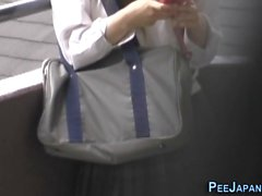 Hot Asian babe schoolgirl is horny and starts masturbating in public and kinky voyeur is spying on her