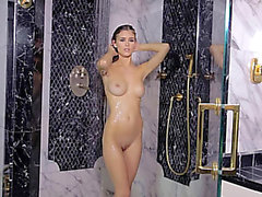 Fit chick takes a shower and plays with her tits