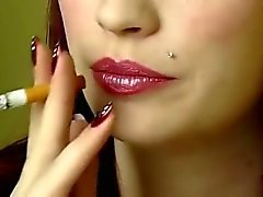 attractive woman smoking a cigarette up close