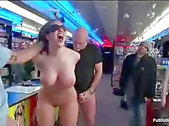 Bound busty babe anal fisted in porn store