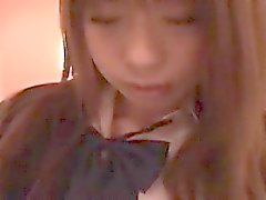 Cute schoolgirl lies on the bed and a kinky guy caresses he