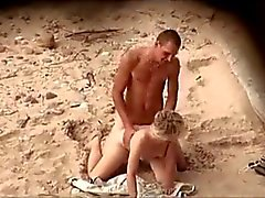 guy with a rock hard cock fucks his girlfriend on the beach