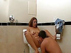 Tattooed babe fucked in bathroom