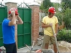 Construction workers and drinking coffee with hot housewife