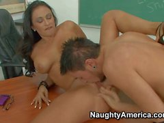 Tanned Claudia with fake balloons rides on Dane in classroom