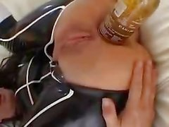 Dilettante brunette hair play with beer bottle in gazoo and vagina