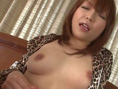 Brunette Asian whore sticks a fuck toy up her pussy