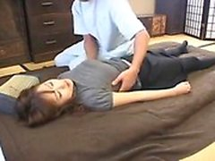 Enticing lady in pantyhose has a masseur working his hands