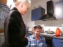Horny blonde granny blows the repairman and gets banged in the kitchen