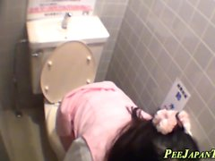 Asian pees in public wc