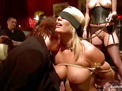 Submissive slave Mellanie Monroe is put on display at a party.