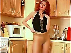 Mature Redhead Has Fun With Her Tan Pantyhose