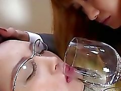 Office Lady With Glasses Kissing Getting Her Face Licked By Schoolgirl On The Couch In The Room