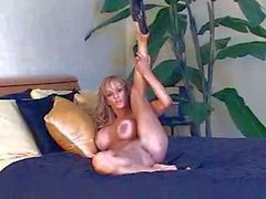 tanned blonde bimbo in stripper shoes has solo action