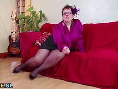 Short haired chubby mature pleasures herself