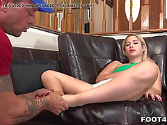 Tiny goldie does an epic footjob