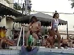 Thai girls dancing by the pool