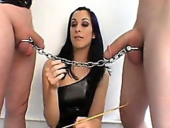 She ties a chain to both pricks and they have a weird tug o