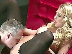 Busty blonde slave in high heels banged in the sofa